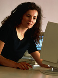 Woman Using a Personal Computer (PC) At Home Photographic Print by Tek Image