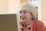 Elderly Woman Using a Laptop Computer Photo by Steve Horrell
