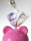 Piggy Bank And British Pounds Prints by Tek Image