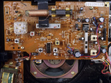Circuit Board In a Portable Radio Photographic Print by Andrew Lambert