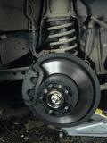Car Disc Brake Premium Photographic Print by Andrew Lambert