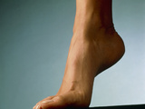 Healthy Foot of a Woman, Raised Onto Its Toes Photographic Print by Phil Jude