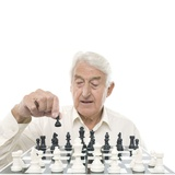 Senior Man Playing Chess Photographic Print by Science Photo Library