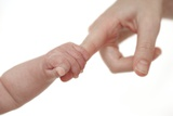 Baby Holding Her Mother's Finger Photographic Print by Ruth Jenkinson