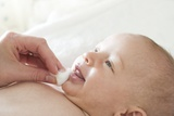 Cleaning Baby Photographic Print by Ruth Jenkinson