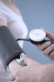 Measuring Blood Pressure Photographic Print by Gavin Kingcome