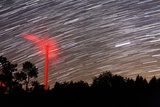 Wind Turbine Under Star Trails Photographic Print by Laurent Laveder