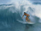 Surfer Riding a Breaking Wave In Hawaii Photographic Print by Brad Lewis