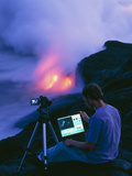 Man Taking Photographs of a Lava Flow Photographic Print by Brad Lewis