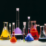 Assortment of Laboratory Flasks Holding Solutions Photographic Print by Tek Image