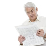 Reading the Newspaper Photographic Print by Science Photo Library
