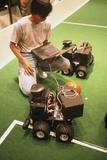 Technician Programs Robot Footballer At RoboCup-98 Photographic Print by Volker Steger