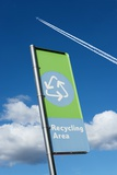 Recycling Sign with Jet Contrail Photographic Print by Mark Sykes