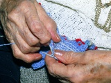 Hands Knitting Affected by Osteoarthritis Photographic Print by Sinclair Stammers