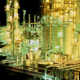 Oil Refinery At Night Photographic Print by Kaj Svensson