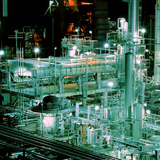 Oil Refinery At Night Premium Photographic Print by Kaj Svensson