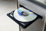 Optical Disc Drive Photographic Print by Johnny Greig