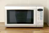 Domestic Microwave Oven Photographic Print by Johnny Greig