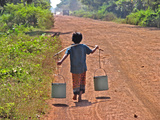 Boy Carrying Drinking Water Posters by Bjorn Svensson