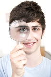 Teenage Boy with Magnifying Glass Photographic Print