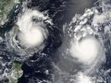 Typhoon Saomai And Tropical Storm Bopha Poster by  NASA