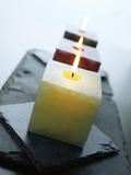 Candles Burning Photographic Print by David Munns