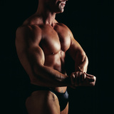 Body Builder Photographic Print by Tony McConnell