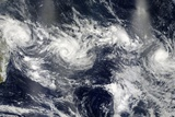 Tropical Cyclones Photographic Print by  NASA
