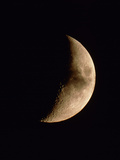 Cloud Crossing a Crescent Moon Photographic Print by Chris Madeley