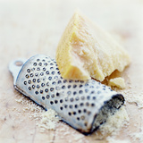 Parmesan Cheese And Grater Photographic Print by David Munns