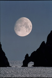 Gibbous Moon Rising Over a Coastal Cliff Photographic Print by David Nunuk
