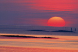 Image of the Solar Disc Upon the Horizon At Sunset Photographic Print by Pekka Parviainen
