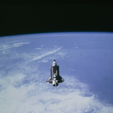 Space Shuttle Challenger STS-7 Orbiting Earth. Photographic Print by  NASA