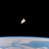 Floating Astronaut Photographic Print by  NASA