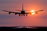 Aeroplane Landing At Sunset, Canada Photographic Print by David Nunuk