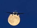 Airbus 330 Passing In Front of the Moon Photographic Print by David Nunuk