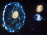 HST Image of Cartwheel Galaxy & Companions Photographic Print by  NASA
