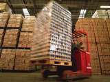 Fork-lift Truck In Warehouse Photographic Print by David Parker