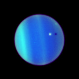 Uranus And Ariel Photographic Print by  NASA