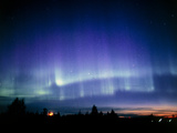 View of a Colourful Aurora Borealis Display Photographic Print by Pekka Parviainen