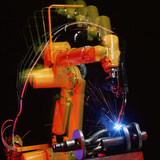 Computer-controlled Electric Arc-welding Robot Photographic Print by David Parker