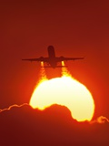 Boeing 737 Taking Off At Sunset Photographic Print by David Nunuk