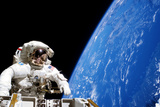 Astronaut Performing a Spacewalk Photographic Print by  NASA