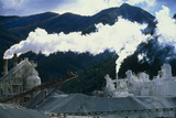 Cement Works with Smoke Coming From Its Chimneys Photographic Print by David Nunuk