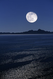 Moonrise Over Sea Photographic Print by David Nunuk