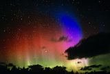 Aurora Borealis Display with Clouds Photographic Print by Pekka Parviainen