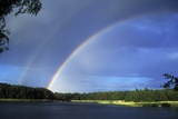 Double Rainbow Over a Lake Prints by Pekka Parviainen