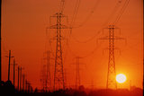 Electricity Transmission Lines At Sunset Photographic Print by David Nunuk