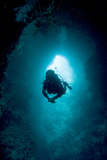 Diver Exploring a Blue Hole Photographic Print by Matthew Oldfield