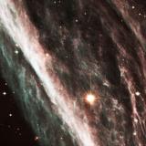 Pencil Nebula Supernova Remnant Photographic Print by  NASA
